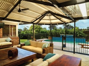 Outdoor living room with skylights and pool safety fence
