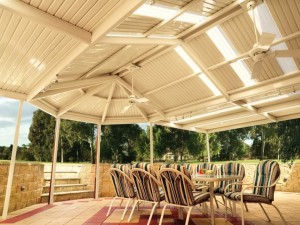 Outdoor gazebo room with ceiling fans and skylights